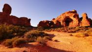 Stock Video Footage of 4K Arches 14 Windows Section Sunset Double Arch Utah USA