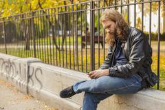 Stock Photo of blond beard young adult hipster man listening music