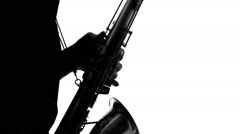 Close up of silhouette of talented musician playing the saxophone Stock Footage