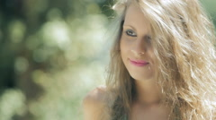 Beautiful blonde woman smiling at the park: having fun outdoor Stock Footage
