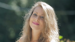 Happy smiling blonde woman in the park: smile, happiness, joyness, carefree Stock Footage