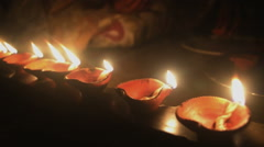Mid close shot of earthen lighted lamps in Deepawali.India. Stock Footage