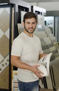 Plumbing, tile, ceramic  and furniture store clerk or client posing Stock Photos