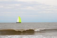 Sailboat on the sea with waves Stock Photos