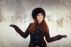 Young Woman in The Snow in Wintertime 2 - stock photo