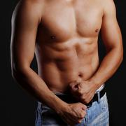 male torso and hands clenched in a fist - stock photo