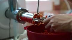 Woman making fresh tomato sauce Stock Footage