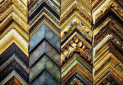 Wooden picture frames in the art salon Stock Photos