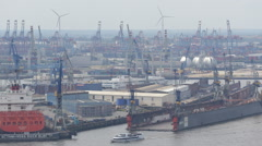Ferry Boat Passing Aerial View Hamburg Port Shipyard Industrial Blohm Voss Dock Stock Footage