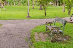 benches in beautiful green park - stock photo