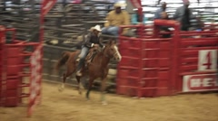 Cowgirl Barrel Racing in Rodeo competition Stock Footage