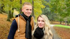 happy couple smiles - young model couple in love - autumn park (nature) - stock footage