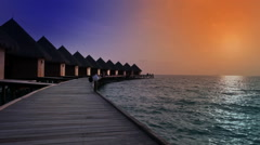 Houses over the transparent quiet sea water . Maldives Stock Footage
