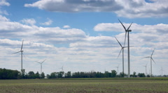 Windmill turbines  in agricultural field - stock footage