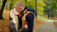young model happy couple in love - couple kiss - autumn park (nature) - stock footage