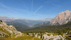4k UHD time lapse clouds contrails over dolomites valley pan 11552 Stock Footage