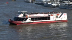 A City Cruises tourist boat on the River Thames, London, UK. Stock Footage