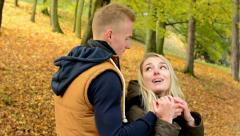 Man surprises woman - young model couple in love - happy couple kiss and embrace - stock footage