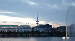 Establishing Shot Dusk Light Hamburg Skyline Alster Lake Water Fountain TV Tower Stock Footage