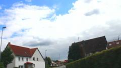 By car through a small German village at the evening - stock footage