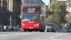 A red London bus & black taxis crossing Westminster Bridge, London, UK. Stock Footage