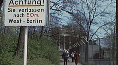 West Berlin 1976: the wall. Brandeburg gate in the background Stock Footage