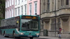 Bus drives along oxford high street, england Stock Footage