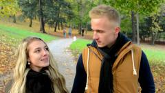 young model couple in love walking in park- autumn park(nature) - couple talking - stock footage