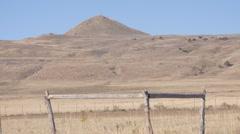 Panning on a mountain range, fences Stock Footage