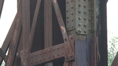 Close up - Iron rivets of a truss railway bridge, built 1863-1865 + zoom out Stock Footage