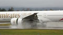 Emirates Boeing 777 landing close view of reversing engine Stock Footage