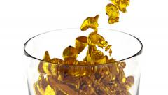 Animated gold nuggets pouring into the glass 2 Stock Footage