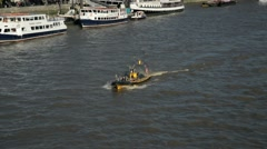 A RIBS boat on the River Thames in London Stock Footage