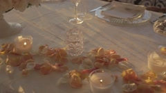 Wedding table petals candles dolly shot Stock Footage