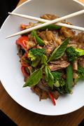 Pad kee mao drunken noodle thai dish with beef and mixed vegetables. Stock Photos
