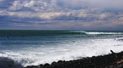 Surfing new zealand point break Stock Footage