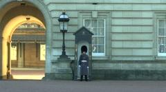 Guard on patrol inside the grounds of Buckingham Palace, London, UK. Stock Footage