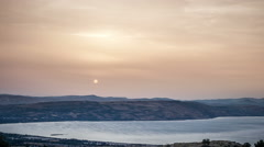 Sea of ​​Galilee with sunset and dusty sky - israel 2012 - DSLR timelapse - stock footage
