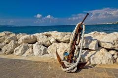 Old rusty anchor by the sea Stock Photos