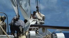 Sailors working on a sailboat Stock Footage
