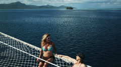Two women on a yacht sunbathing Stock Footage