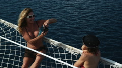 Two women on a yacht taking a photo Stock Footage