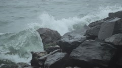 Waves crash upon the rocks Stock Footage