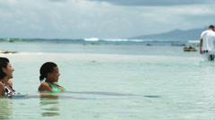 Two women swimming in the ocean Stock Footage