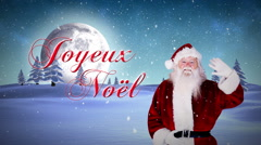 Santa waving at camera with joyeux noel message - stock footage