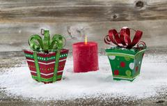 Holiday gifts on aged wood and snow Stock Photos