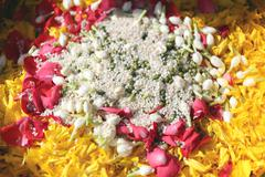 Popped rice and flowers in utensil. Stock Photos