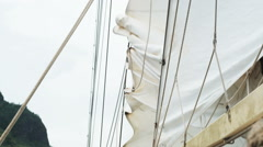sailors taking down a sail - stock footage