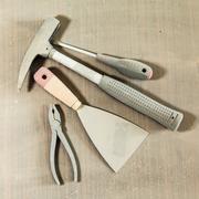 set of tools under dust - stock photo