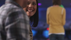 Young woman and friends at a bowling alley Stock Footage